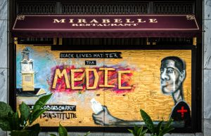 A mural in Washington DC depicts a life-saving Black Medic and the slogan Black Lives Matter.