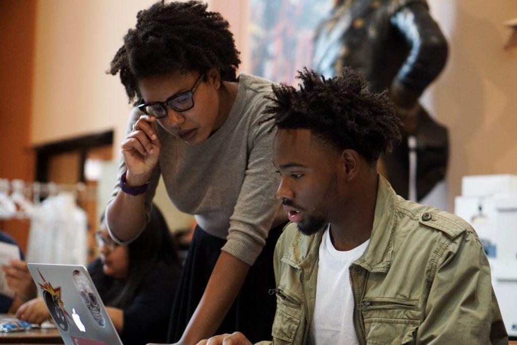Graduate students at a computer